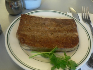 Country scrapple, next to some kind of twig